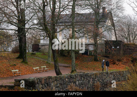 Wooden houses near the main quay on Suomenlinna Island, Helsinki, Finland. Some of the houses of the inhabitants - Stock Photo