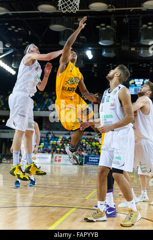 London, UK. 3rd January 2016.  London Lions' Andre Lockhart (6) jumps up to the basket with Plymouth players Adrien - Stock Photo