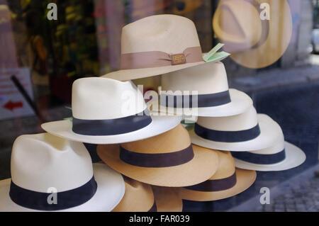 Display of Panama hats in Lisbon shop window. - Stock Photo