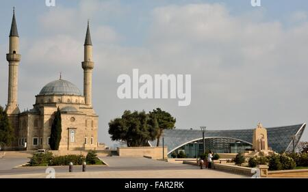 Mosque and funicular station in Baku, capital of Azerbaijan. A scene in Baku with old and modern buildings - Stock Photo