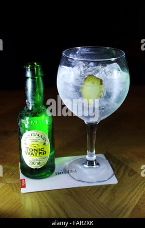 Gin and tonic served in Rotterdam, the Netherlands. The drink is served with Fentiman's tonic. - Stock Photo