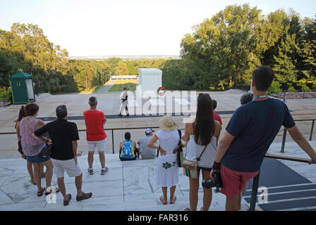 Tourists watching the Changing the Guard at the Tomb of the Unknown Soldier in the Arlington National Cemetery, - Stock Photo