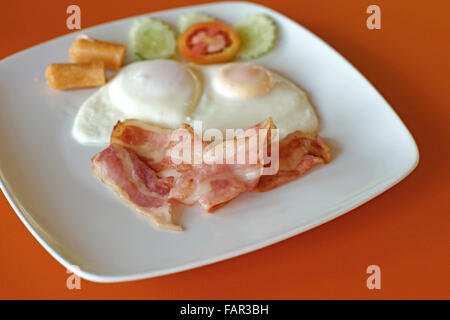 egg sausage ham and bacon breakfast served with hash browns and stock photo royalty free image. Black Bedroom Furniture Sets. Home Design Ideas