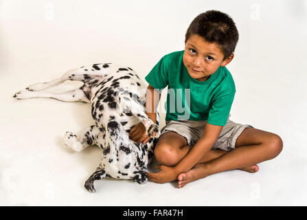 multi ethnic inter racial diversity racially diverse multicultural interracial Expressive Young boy dog above high - Stock Photo
