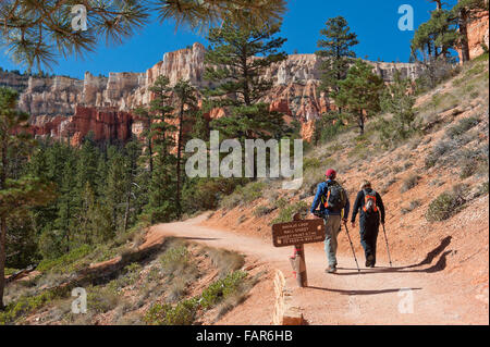 Two hikers on a trail in Bryce National Park. - Stock Photo