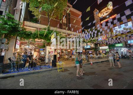 Tourists enjoying Khao San Road in Bangkok, Thailand - Stock Photo
