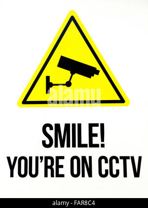 Sign reads: Smile you are on CCTV. Security concept - Stock Photo