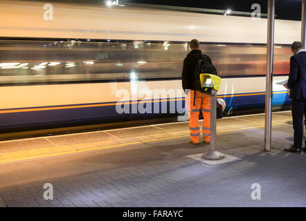 Early morning commuters waiting for train at Southampton Airport Parkway station. Hampshire, England. UK - Stock Photo