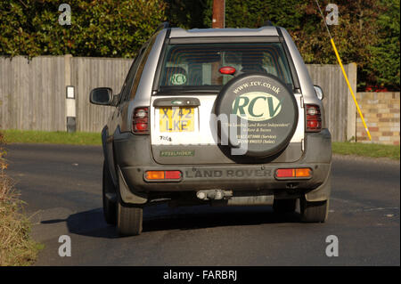 2000 Land Rover Freelander 4x4 car driving around a corner in the country - Stock Photo