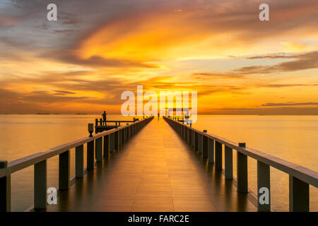 Summer, Travel, Vacation and Holiday concept - Wooden pier between sunset in Phuket, Thailand