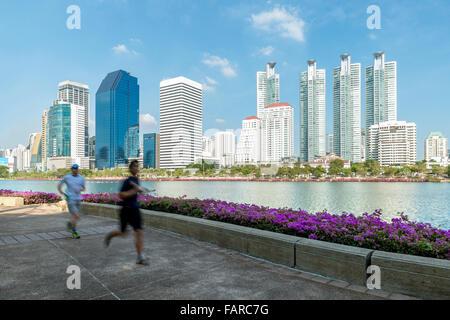 People running in morning at park, Bangkok, Thailand - Stock Photo