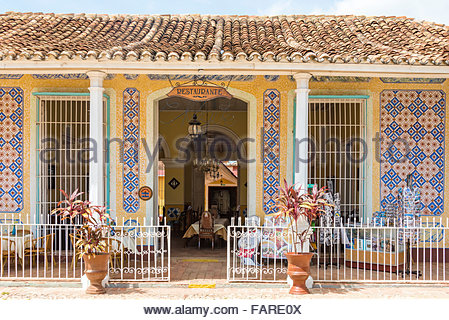 Facade of old colonial house turned into a restaurant in  Trinidad,Cuba. - Stock Photo