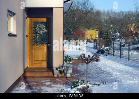 VILNIUS, LITHUANIA - JANUARY 02, 2016: Christmas  wreath on a door of the rural house. Holidays came to an end. - Stock Photo