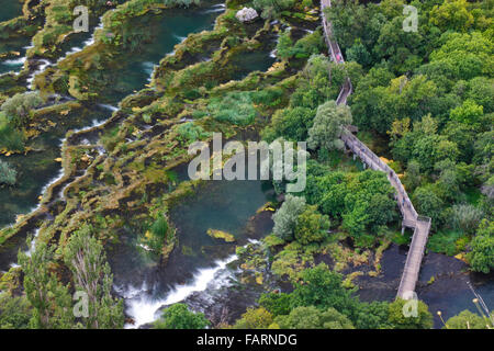 Wooden bridge over river Krka in National park Krka, Croatia - Stock Photo