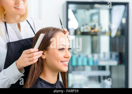 Stylist is working with her client. - Stock Photo