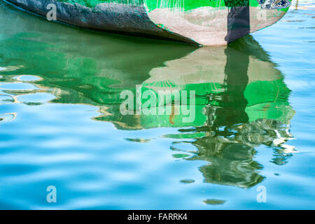 Boat with reflection in water. - Stock Photo