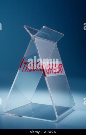 stock image of document holder with urgent sign - Stock Photo