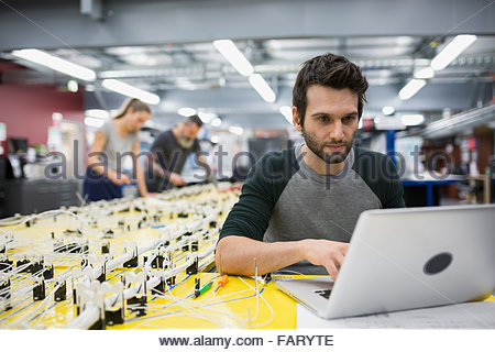 helicopter technician using laptop at wiring harness stock. Black Bedroom Furniture Sets. Home Design Ideas