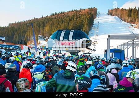 Crowd in queue for a ski lift in Bukovel. Bukovel is the most popular ski resort in Ukraine. - Stock Photo