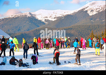 Lots of people at top of a slope in Bukovel. - Stock Photo