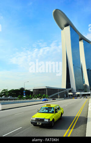 Taxi cab driving by the road in front of Marina Bay Sands hotel in Singapore. The government will spen