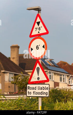 Road signs in Poole showing height and width restrictions and road liable to flooding - Stock Photo