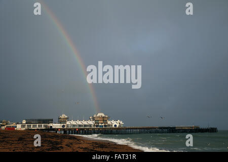 Southsea, Hampshire, UK. 4th January, 2016. UK Weather: A rainbow shines over South Parade Pier at Southsea in Hampshire, - Stock Photo