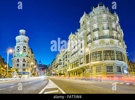 grassy building and gran via street at the blue hour madrid spain