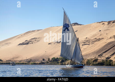 Felucca, traditional wooden sailing boat on the river Nile near Aswan southern Egypt - Stock Photo