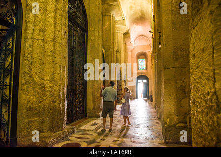 Cathedral Syracuse Sicily, interior view of tourists looking at the ancient Greek columns inside the Duomo itself, - Stock Photo