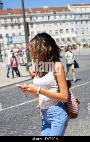 Looking at cell phone. - Stock Photo