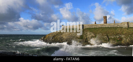 Peel Castle, Peel, Isle of Man. The mouth of Fenella Beach on a stormy day with large, powerful waves crashing on - Stock Photo