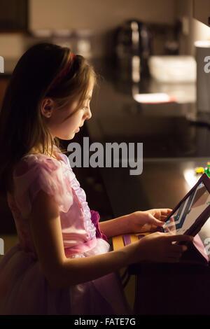 Young girl using her ipad - Stock Photo