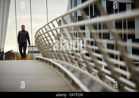 Mediacity Granada ITV Coronation Street set in Salford Quays   modern design foot bridge walkway path crossing ship - Stock Photo