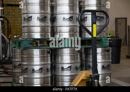Beer barrels inside the Side Launch brewery in Collingwood, Ontario, Canada. - Stock Photo