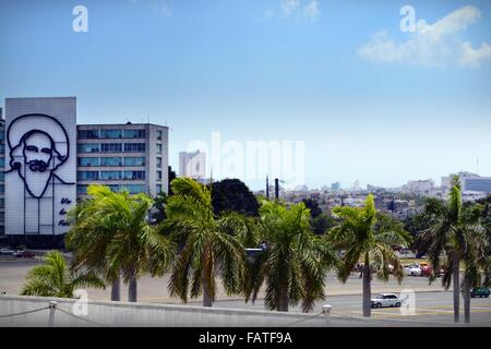 image of Cienfuegos on the building across Revolution Square Cuba, palms swaying and traffic pass, view from Jose - Stock Photo