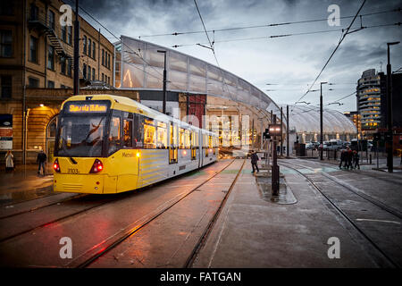 Manchester Metrolink tram leaving Victoria Station along second crossing   Tram metrolink light rail rapid commuters - Stock Photo