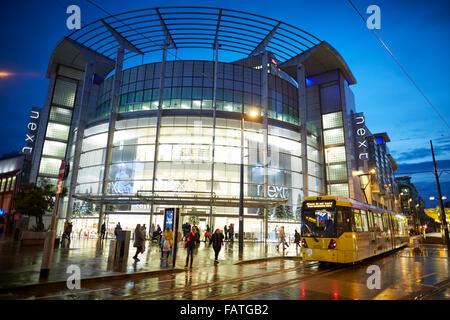 Manchester Metrolink tram along second crossing at the Arndale Exchange Square   Tram metrolink light rail rapid - Stock Photo