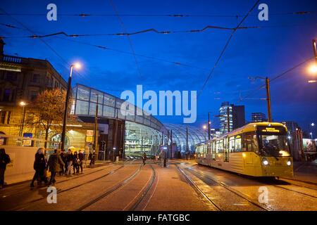 Manchester Metrolink tram along second crossing at Victoria Station   Tram metrolink light rail rapid commuters - Stock Photo