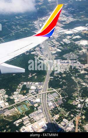 View from Southwest Airlines airplane window overlooking freeway - Stock Photo