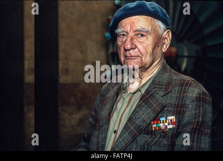 A head and shoulders portrait of a male  World War II Soviet Veteran wearing a beret and a sport coat in the Siberian - Stock Photo