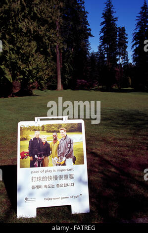 Trilingual Sign written in English, Chinese Mandarin, and Korean Language - Pace of Play Rules, Notice to Golfers - Stock Photo