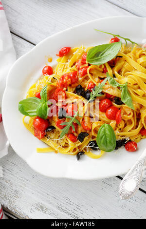 pasta with tomato sauce on white plate, food - Stock Photo