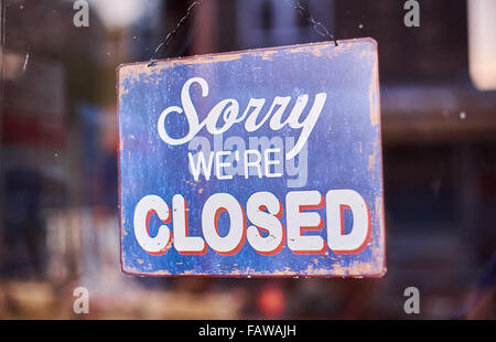 Sorry We're Closed shop door sign in blue and white - Stock Photo