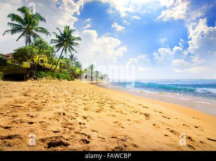 Sunlight over beautiful tropical beach near ocean - Stock Photo
