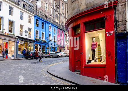 View of shops on historic Victoria Street and West Bow in Old Town of Edinburgh Scotland United Kingdom - Stock Photo