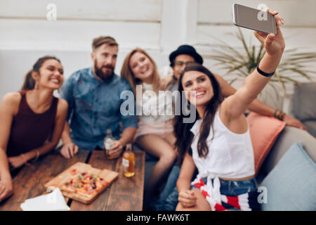 Group of friends having a party on the rooftop making a selfie to remember this perfect moment. Happy and joyful - Stock Photo
