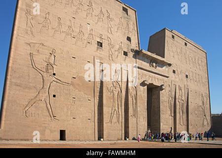 Pylon of the Temple of Edfu, dedicated to the falcon god Horus, Egypt - Stock Photo
