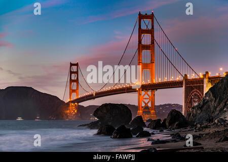 Golden Gate Bridge, Marshall's beach, night, rocky coast, San Francisco, USA - Stock Photo