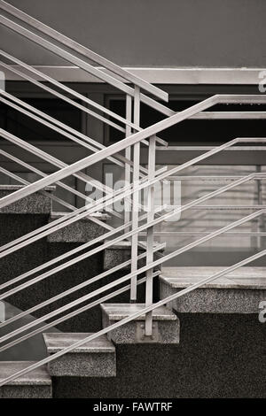 Going up? Concrete stairs with metallic fence. - Stock Photo